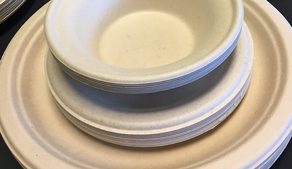 A photo of plates and bowls stacked