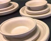 Molded fiber plates and bowls stacked together